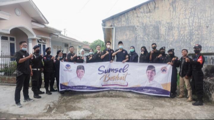 Garda Pemuda NasDem Sumsel Bagikan Sembako untuk Warga Kurang Mampu